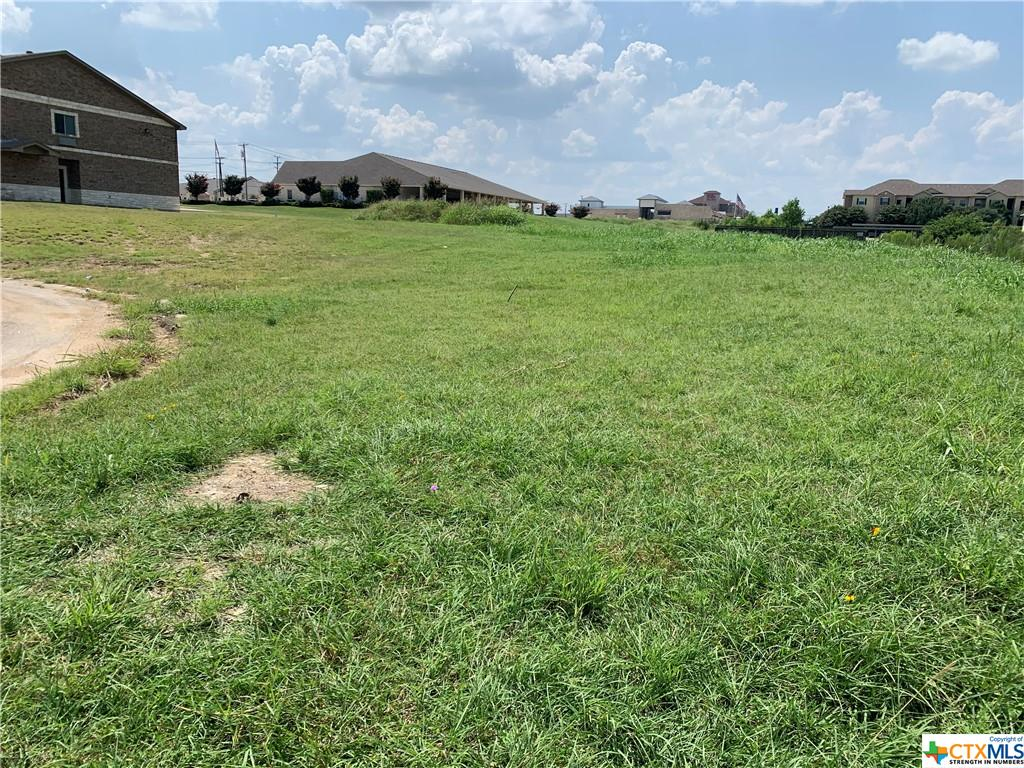 Commercial lot, almost an acre in size, situated in a cul de sac ready for your commercial needs. Large cul de sac allows entry to the lot. Fire hydrant already in place. Located behind local dentist office, established title company, and a small inn and suites. Zoned as B-5.