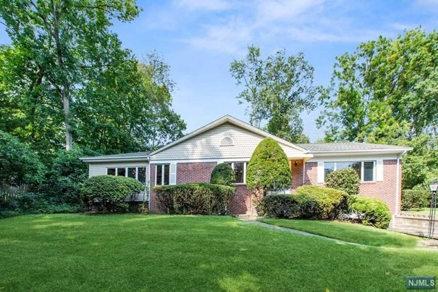 STAGED & APPOINTED,THIS LOVELY CUSTOM SPLIT RANCH PROUDLY SITS AT A CUL-DE-SAC ON OVER 1/3 ACRE. IT HAS BEEN RENOVATED AND VERY WELL MAINTAINED. SPECIAL FEATURES INCLUDE A LG FORMAL LIVING RM WITH PICTURE WINDOW, DINING RM W/BUILT-INS & PICTURE WINDOW, MODERN EAT-IN KITCHEN W/ISLAND, CEASAR STONE COUNTERTOPS, STAINLESS-STEEL APPLIANCES, PLENTY OF CABINETS. THE SUNNY & BRIGHT FAMILY RM FEATURES WALLS OF WINDOWS, CATHEDRAL CEILINGS PERFECT FOR MORNING COFFEE. SLIDING GLASS DOORS LEADING TO LOVELY DECK. SECOND LEVEL BOASTS 3 GOOD SIZE BR, GREAT CLOSET SPACE.MAIN BEDROOM STE OFFERING 3 CLOSETS & NEWER BATH W/WALK-IN SHOWER & PEDESTAL SINK. LOWER LEVEL HAS A HOME OFFICE/GUEST RM, RENOVATED FULL BATH & LAUNDRY RM. JUST FEW STEPS DOWN TO THE GRADE LEVEL IS A LG FAMILY RM W/SEPARATE ENTRANCE & ACCESS THE OVERSIZED ATTACHED GARAGE. BEAUTIFUL LANDSCAPED PROPERTY OFFERING A SPACIOUS DECK OVERLOOKING THE PRIVATE & PICTURESQUE BACKYARD. CONVENIENTLY LOCATED NEAR NYC BUS & TRAIN TRANSPORTATION