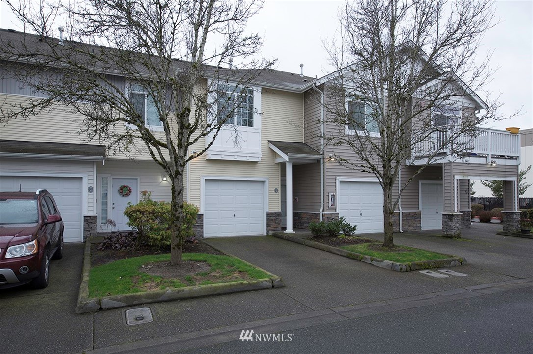 Located near I-5 in Fife, here's a newer feel condo home with two bedrooms, two full bathrooms, and attached garage. This upper unit has wonderful lighting. 9 foot ceilings make for a roomier and open feel. Kitchen with breakfast bar overlooks the good sized dining room and great room with a gas fireplace providing warmth on cold days.  A slider in the living room opens to the deck to BBQ or just hang out. Master bedroom is good sized with a full bathroom and a walkin closet. Engineered laminate flooring makes for EZ cleaning and looks great! Shopping, schools, fast foods, restaurants are nearby. As a no frills, well designed, well maintained smaller complex, the HOA dues are super reasonable. All appliances are included.