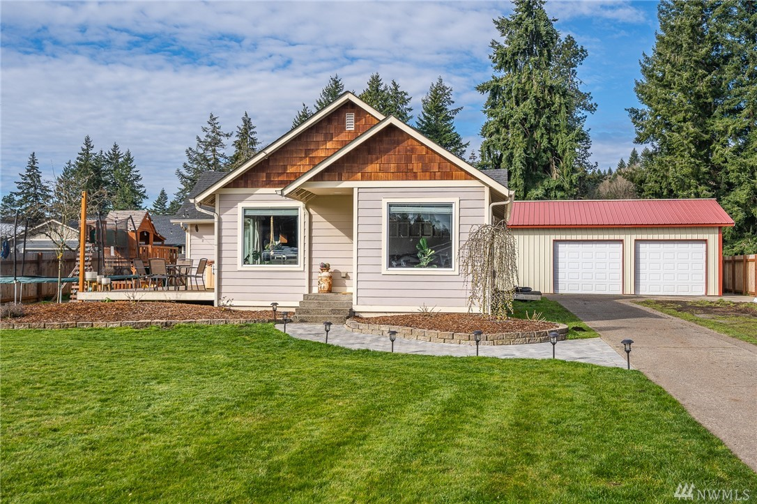 Lovely home on large 1/3 of an acre lot. Tastefully updated and remodeled. Great open floor plan with spacious deck for entertaining. Lots of room for your toys and outdoor equipment on the property and in the shop.  Private well for irrigation.  A must see today - won't be available for long!