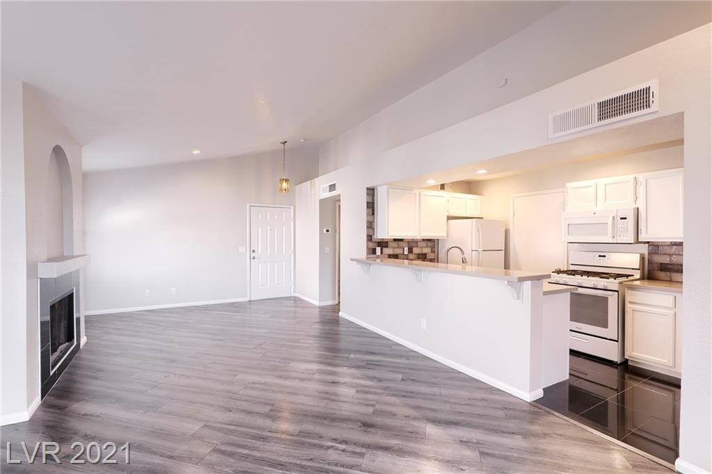 STUNNING & RECENTY RENOVATED CONDO SITUATED IN A POPULAR SPRING VALLEY COMMUNITY*GREAT INVESTMENT OPPORTUNITY WITH THIS TURN-KEY, UPPER LEVEL UNIT HIGHLIGHTED BY MODERN, CUSTOM FINISHES, COMMUNITY POOL & PREMIER LOCATION*HERE YOU WILL FIND A DESIRABLE & FUNCTIONAL FLOOR PLAN FEATURING 1,023sqft ~ 2 LARGE BEDROOMS & 2 FULL UPGRADED BATHROOMS*ENJOY A LARGE GREATROOM WITH VAULTED CEILING & GAS FIREPLACE ADJACENT TO A GORGEOUS, UPGRADED KITCHEN & DINING AREA*STEP OUTSIDE TO A COVERED BALCONY*ALL OF THIS PLUS THE ADDED VALUE OF NEW 2-TONE PAINT, LUXURY UPGRADED WOOD & TILE FLOORING, PREMUIM CARPET, PLANTATION SHUTTERS, CEILING FANS, UPGRADED BASEBOARDS, QUARTZ COUNTERS & ALL APPLIANCES INCLUDED*GREAT LOCATION! CLOSEST BUILDING TO COMMUNITY POOL & SPA*GATED COMMUNITY*LOTS OF GUEST PARKING*IDEAL SPRING VALLEY LOCATION WITH CONVENIENT ACCESS TO PARKS, SCHOOLS, SHOPPING, RESTUARNTS & MORE!