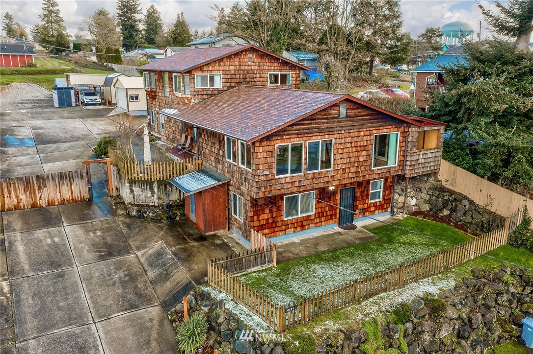 This beautiful large updated home is situated on .64 acres with sunset views of mountains. Can be a SFR or set up as a triplex rental.  Home's main level has living/dining is 2000sqft w/ 2BR/2BA, office, XL walk-in closet, fully updated kitchen w/Meile commercial oven & DW. Upstairs is a 2br/1ba MIL, full kitchen, w/d. Lower unit is 1br/1ba, kitchen w/separate yard space. Dubbed the Sunset Cottage for Air BnB, the multiple separate living spaces would make great multi-generational living. The building upgrades include new roof, upgraded kitchens and baths, too much to list. Plenty of parking/storage for each unit, a detached 2 car garage, covered RV /boat parking and carport. Great access freeways, airport, shopping, public transit, parks.