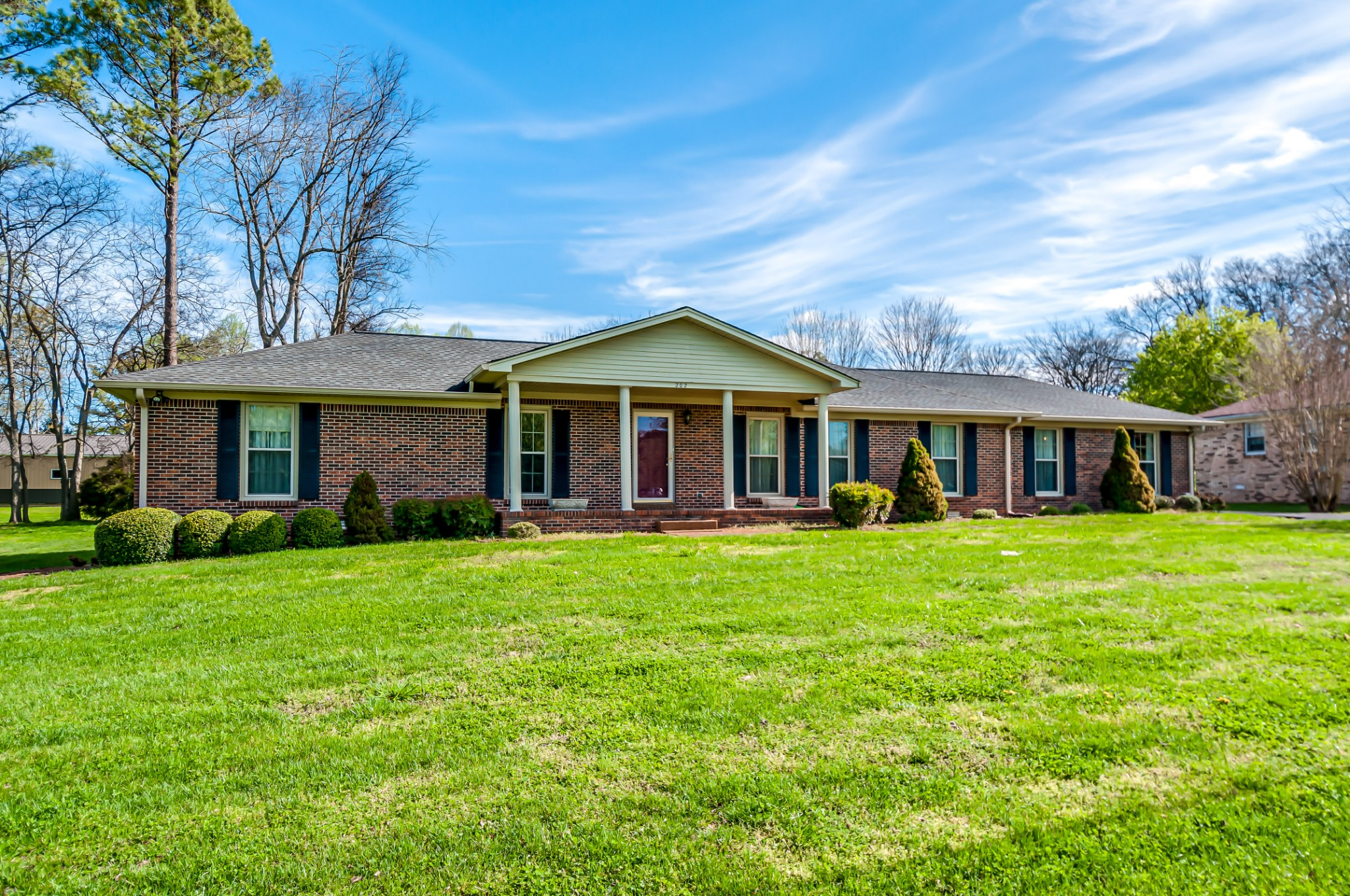 Brick Ranch home, close to town, large yard.  Covered carport and garage. Outbuilding. New electrical panel. Vinyl windows, newer roof, gas fireplace.  Home is being sold in AS-IS condition to settle estate.