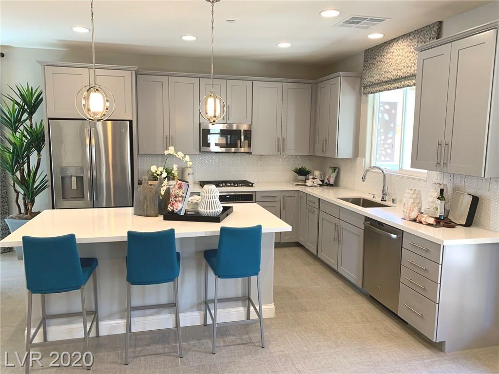Model home -- first-floor bedroom w/full bath; extended covered patio with balcony at master bedroom, gourmet kitchen configuration w/GE Epicurean stainless-steel appliances inc counter-depth refrigerator, 8' interior and exterior doors, 9' ceilings throughout, upgraded and additional insulation, washer/dryer, walk-in shower at master bath, Premier maple cabinets w/painted stone finish and door hardware, tile backsplash at kitchen, upgraded quartz kitchen, bath and laundry countertops; master and bedroom 2 closet organizers, upgraded chrome bath faucets and accessories, upgraded carpet and ceramic tile flooring throughout; two-tone interior paint, modern stair rails w/smoke finish, upgraded interior trim package, laundry sink and cabinets, security system, whole-house technology package, complete landscaping, and more!