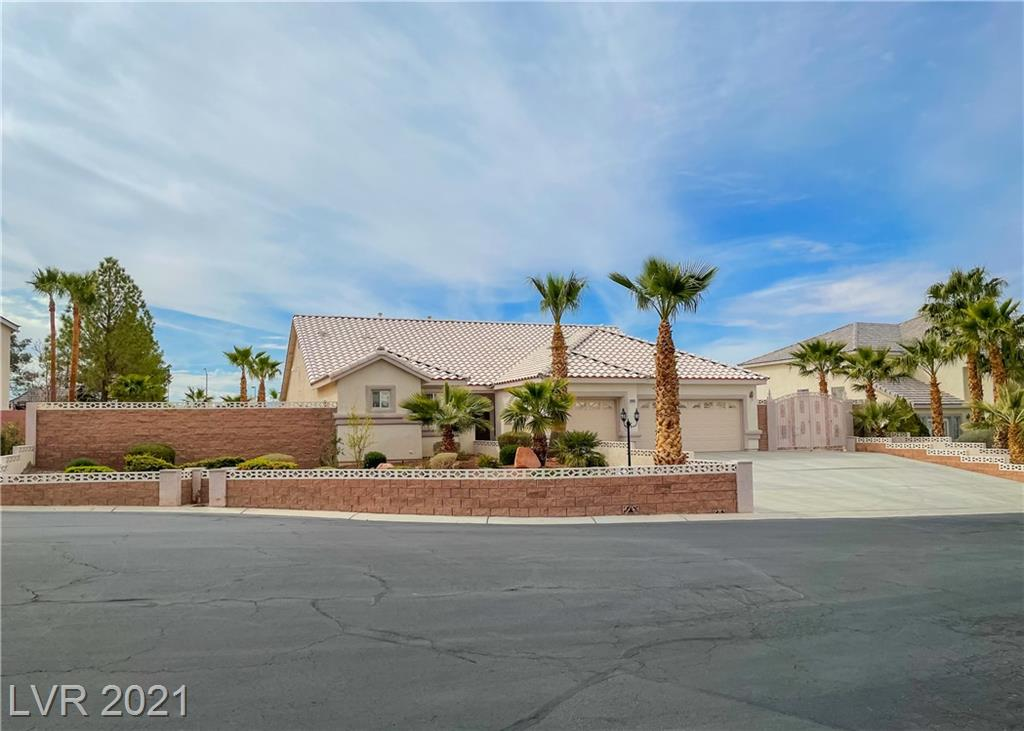 This home has everything your looking for!!! An entertainers delight! Rare Single story on a half acre with RV parking, Beautiful pebble tech pool, spa and 3 waterfalls. Outdoor kitchen with fridge, sink, side burner, sear station and grill. Huge balcony with wonderful panoramic city views. Regulation size horseshoe pit, fountain pond and mature landscaping. Lots of room for your toys and close proximity to the Lake. Enclosed sun room to enjoy your morning coffee. 10K flooring credit -- Las Vegas light fixture above pool table is excluded from the sale. 2 year transferable Home Warranty included.