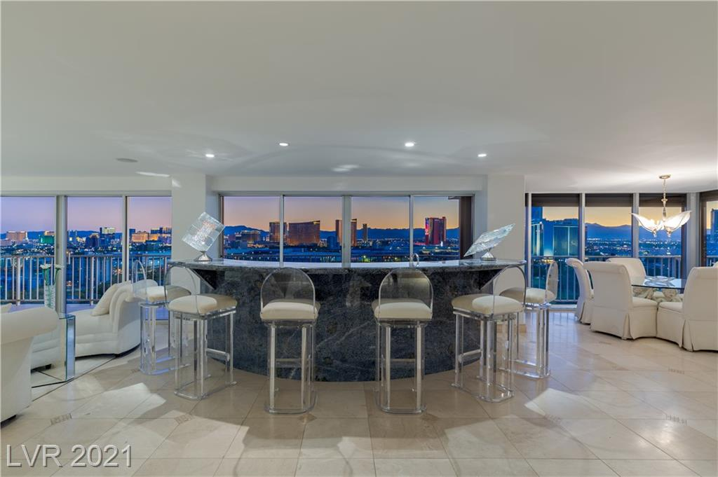 Customized home in the skies. 3,942 sq.ft. including balconies. Two high-rise condos  w/ 1,856 sq.ft. each 21A & 21C are combined into one large residence making this exclusive & spacious 3,712 sq.ft. interiors condo a one of a kind. The tax records only show one of the parcels under the address for 21A, however, 21C also is included. INCREDIBLE & best Las Vegas Strip, Golf course, Mountains and Downtown VIEW. This residence offers the most unique set up for those seeking for uniqueness. Furnished & the interiors was designed w/ lightness & practically in mind. White walls, rich blue stone counters, open & large rooms w/ floor to ceilings walls. Electronic shade throughout & fully furnished. Regency Towers is an iconic building located inside the reputable Las Vegas Country Club surrounded by the most peaceful atmosphere and security. Locate minutes to the Las Vegas International airport, best dining, shopping & entertainment. Welcome home!