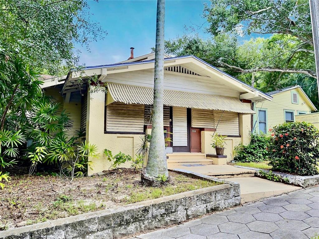 Charming home ready for you to fix up right in the middle of Historic Roser Park.  Property rarely becomes available in this neighborhood. Hidden away and very close to Downtown St Petersburg. Being sold As-Is.  This home is not move in ready and needs a complete renovation. The setting looks at other historic homes with lush tropical flora surrounding it.  You can walk to the canal lined park everyday and only minutes to the city center.