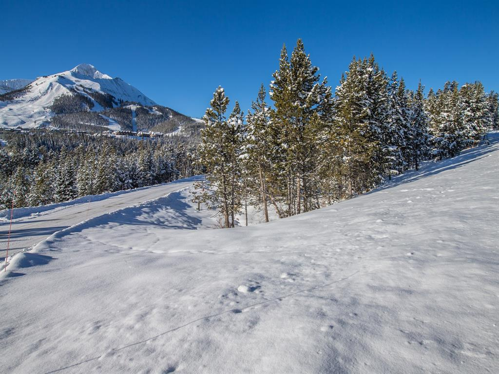 Enjoy designing and building your Montana mountain home from this ski in/ski out homesite in the popular Cascade neighborhood. Take advantage of the gently sloped topography and massive views of Lone Peak and surrounding ski runs. Conveniently located between Moonlight Basin Resort and Big Sky Resort you are always a quick drive to the mountain amenities and shopping.