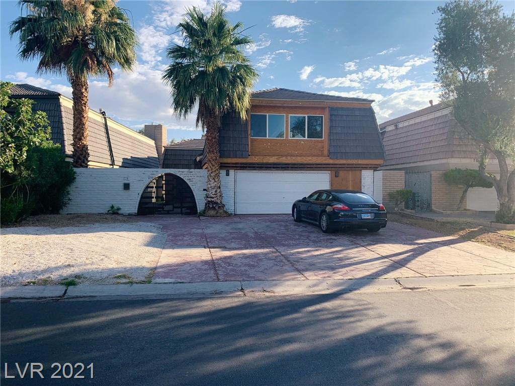 JUDT LISTED***IN CELEBRITY FAMOUS LAS VEGAS COUNTRY CLUB*  GOLF COURSE *BIG FIXER (3500 SQ FT) ON OVER SIZE LOT * BRAND NEW  HEATED  POOL AND SPA*YOUR OWN PRIVATE GATE ONTO FAIRWAY .ENVIABLE LOCATION  ADJACENT TO 15TH GREEN* SPECTACULAR LUSH GREEN GOLF VIEWS & THE STRIP FROM BACKYARD *PHENOMENAL PRIVATE IMPRESSIVE GATED COURTYARD ENTRANCE.*DRIVEWAY HANDLES 6 CARS* 2 BRAND NEW HVAC SYSTEMS* THE HUGE INTERIOR  NEEDS NEW FLOORING, KITCHEN CABINETS, ,,MASTER BATHROOM  , REAR BALCONY, EXTERIOR AND INTERIOR .PAINT AND FINISHING.. THERE ARE 2 WOOD-BURNING FIREPLACES (MASTER BEDRM & GREAT ROOM, BIG MAIN FLOOR HOME OFFICE OR GANES OR MEDIA ROOM GAMES ROOM WITH 3PIECE BATHRM DOWNSTAIRS) OWNER WAS INTENDING TO FINISH INTERIOR BUT INVOLVED IN OTHERF PROHECTYS . FANTASTYIC INTERIOR LAYOUT WITH ALL BIG ROOMS, H CEILING IN FAMILY RM. AND SPIFFY FLOATING STAIRCAS TO GALLERY 2ND FLOOR SPORTING A 30X26 MASTER BEDRM WITH  FIREPLACE AND BALCONY. & 2 OTHER KING BEDRMS  SOLD AS IS NO REPAIRS BY SELLER.