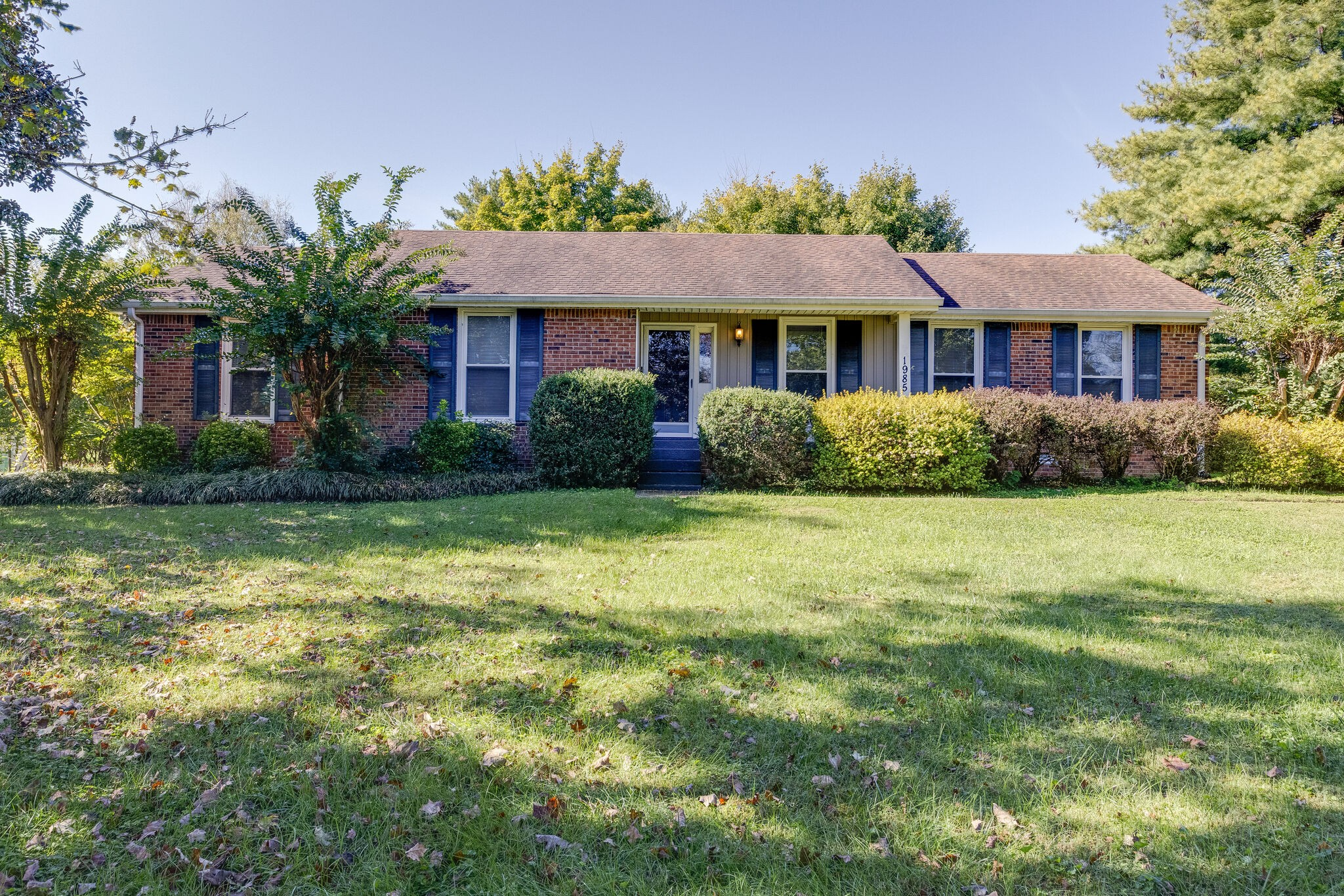 Private almost 1 acre flat lot w/NO HOA~Convenient to I-65, Downtown Franklin & Cool Springs~One level living~3/2 with bonus, formal dining, living room, den with fireplace and eat-in kitchen~Surrounded by mature trees~Roof(2007) & HVAC(2018)~Sheds remain~Excellent opportunity to add-on or tear down and build new
