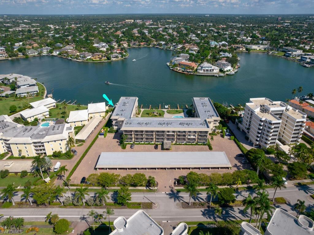 Enjoy your morning coffee overlooking the Moorings Bay! This 2 bedroom 2 bathroom condo is located on the fourth floor with wonderful views over the pool area and Moorings Bay. This condo has a deeded carport space and storage locker. Coquina Club is beautifully maintained and enjoys wonderful landscaped grounds and leased boat docks. Enjoy time by the pool overlooking the bay or relax on the dockside seating areas.
