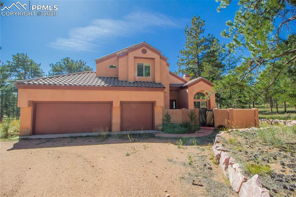 Enjoy the Good Life in this Mediterranean-style 2-story home on nearly 4 acres with legal access to National Forest and only a few minutes to all the fun at 11-Mile Reservoir!  This beautiful, low-maintenance stucco home has tiled roof, concrete patios, and sits on a fully usable level lot.  The front entry opens to vaulted ceilings, cozy gas fireplace, and lots of natural light shining through windows that take full advantage of the southern exposure. 2 upper-level Master Suites, one featuring a 5-pc Bath with double