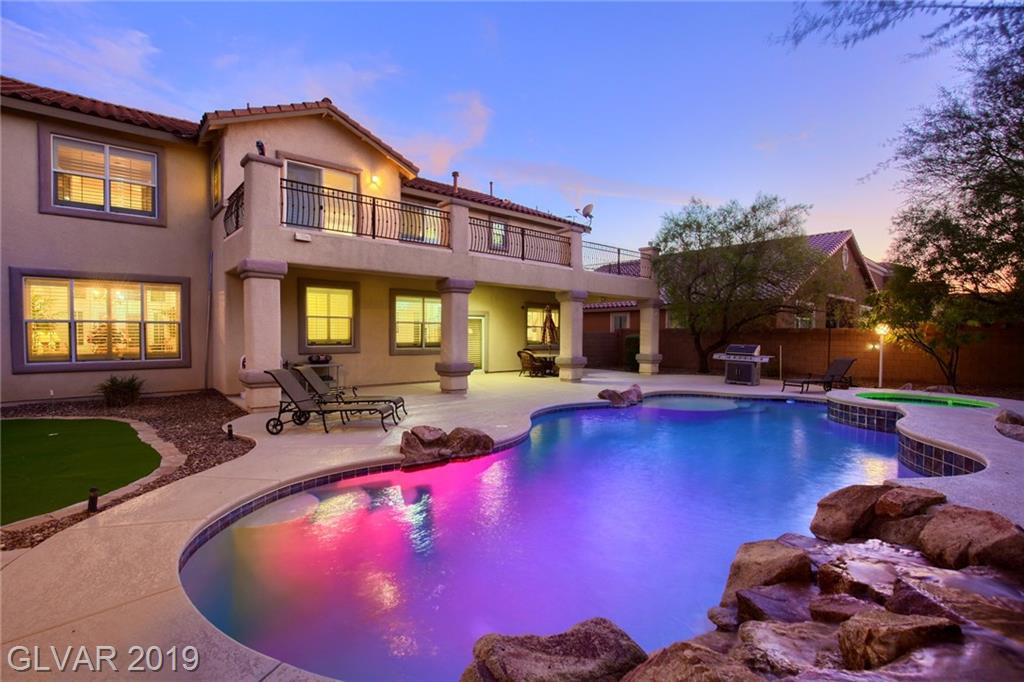 Meticulously maintained home is perfect for entertaining, located on a corner lot in Mountains Edge. Enjoy the backyard oasis with an over-sized pool and spa. Spectacular balcony views! Conveniently located near shopping and restaurants. An easy drive to McCarran airport and the Las Vegas Strip! Features include 5 beds,3 baths,dining room, master suite with dual sinks and jetted tub! Large family room with gas fireplace and shutters throughout.