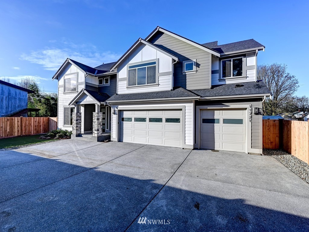 Versatile floorplan - 6 Bedrooms or 5 & bonus or 4 den/bonus,all w/closets. 1st flr hardwds thruout. Bedrm w/adj 3/4 bath on 1st floor. Perfectly laid out SS kitchen w/lots of cabs/ctr space & generous island; large eating area & party size grt rm w frplc. Upstair 4 beds/bonus/laundry/aux ba w/dbl sinks. Master w/huge /5 piece bath & walk-in closet. Huge windows & Lots of light. 3 car gar; big driveway & lot. Less than a mile to lite rail; 10 miles to Pike Place; quick access to all necessities.