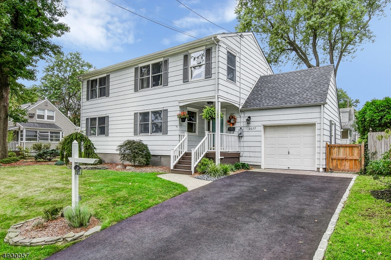 Absolute turn-key 3 Bed / 2.5 Bath colonial in desirable Maple Hill section is conveniently located to schools, parks, prestigious downtown Westfield & NYC transportation. Wonderful chef's kitchen w/center island, granite counters & dining area. Living room, family room & powder room complete this level. Upstairs, you'll find the master suite with walk-in closet & private bath w/stall shower, plus two more bedrooms & a hallway bath w/tub shower. Newer finished basement w/walk-out includes a rec. room w/wood burning stove, utility & laundry room. This wonderful home also includes newer roof, newer HVAC & ductwork, CAC, one car garage & driveway, hardwood flooring, attic for extra storage, plus gorgeous paver patio overlooking the tranquil fenced-in yard & much more! Just minutes to McGinn Elementary school.