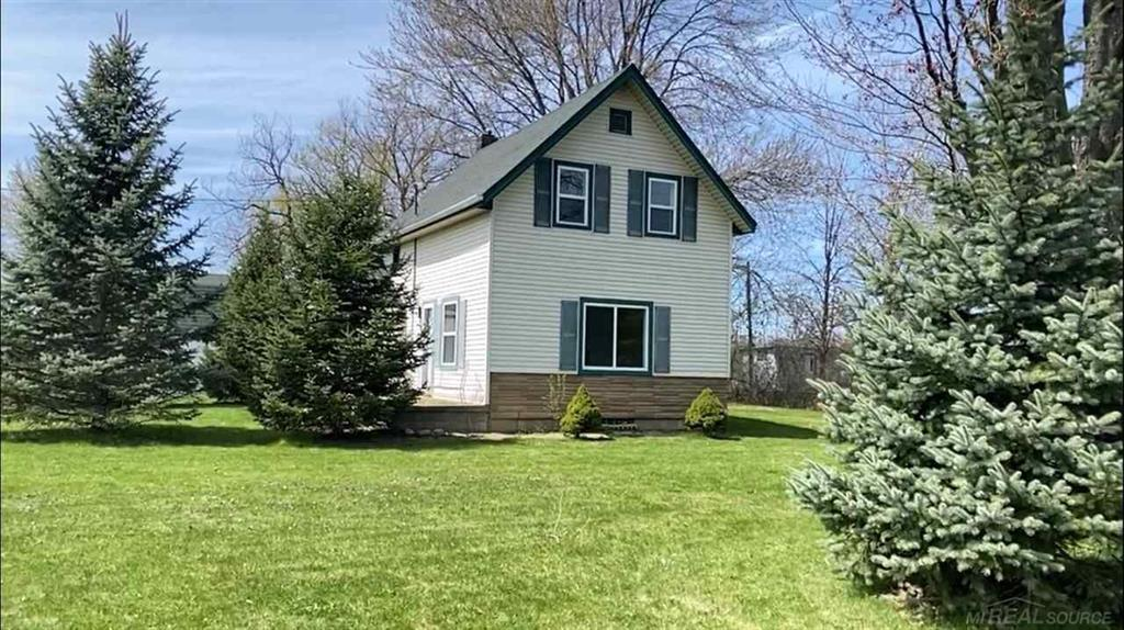 Enjoy country living and abundant wildlife in this updated farm style home nestled on 40 acres of land. Home updates include newer roof, windows, furnace, hot water heater and totally updated bathrooms. The large upstairs bedroom and sitting area could be converted into a second bedroom. Plenty of room for expanding. Also situated on the property is a 64x72 cinder block building great for storage or workshop, 18x34 garage and 16x16 shed. All of this located just minutes from the city of Yale.  Farmer retains crop rights through 12-31-2021. Trailer on property stays with sale. Excludes attached metal shelving and Plymouth Wagon in block building and Fiat in garage. All other contents in buildings are negotiable.