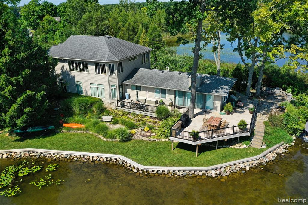 Beautifully maintained home on peninsula of Lakeville Lake! With approx. 500 feet of water frontage, this home has water views in almost every room of the house! This property has been professionally landscaped with a unique meditation garden and plenty of room for outdoor relaxation and entertainment! Outdoor features: new sea wall (2019), irrigation system, brick paver driveway & walkway, large deck for entertaining, dock for boat, and built in fire pit. Plenty of storage throughout the home including mudroom/large pantry area. 44 thermo E-gas filled windows installed in 2009. Windows trimmed with wood casings. Three stacked crown molding throughout the home. Master suite features balcony and three season area. Jetted tub, stand-up shower, dual vanity in master bath. Quartz countertops in kitchen and new stainless steel appliances in 2019. Furniture items are negotiable.