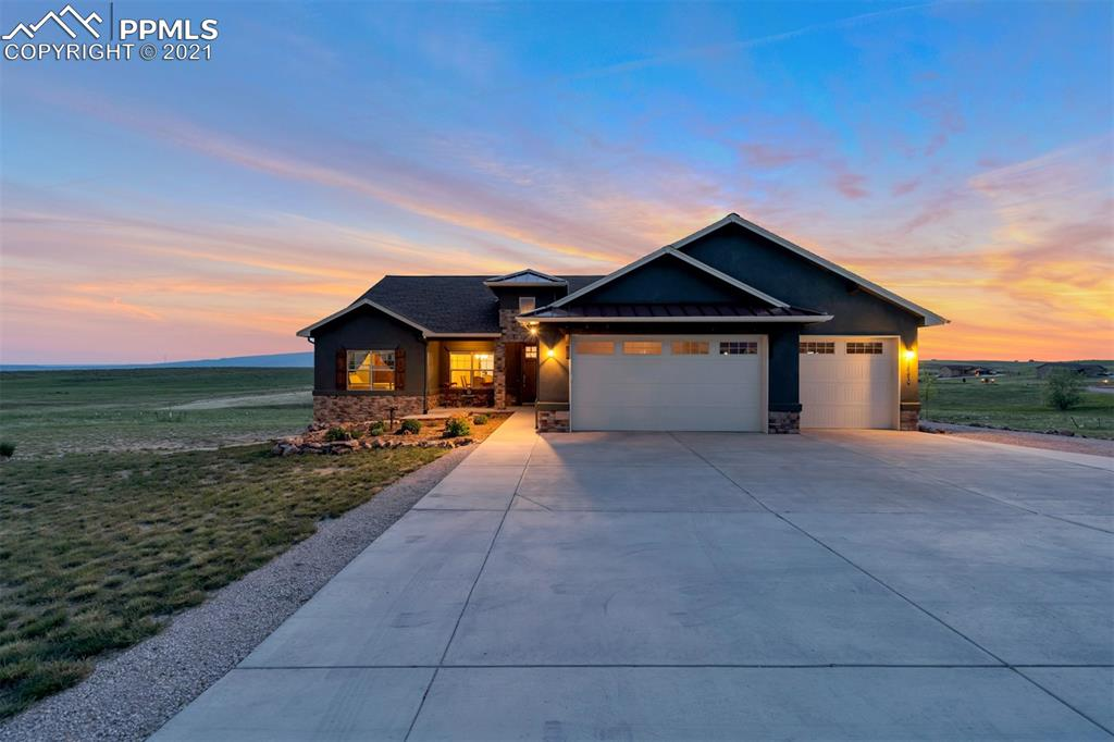 Stunning Custom Built Home with Main-Floor-Living, 9 foot ceilings throughout the home, wood floors, Custom Alder cabinetry, gas range, walkout basement, VIEWS and so much more! You will not want to miss this Ranch Style Home on 2.97 acres with Amazing Mountain Views from most rooms (even the walk-out basement).  Enjoy the deck off the kitchen and get ready for the best 4th of July celebration as you watch multiple firework shows.  This peaceful, home in the country has one-of a kind touches such as Tray Ceilings, oversized doors and oversized windows with views and natural light.  Wood Flooring on Main-level, Gourmet Kitchen, Granite Counters, Separate Formal Dining Room Area.  The oversized walk-out basement is ready for you to add your own mini-bar or make it a mother-in-law suite with a full kitchen. Some of the Extras Include: Hunter Douglas Window Shades, Laundry Room on Main-level with a Sink, Garage Freezer, humidifier, AC Ready, additional detached garage with RV garage door & opener and additional workshop. The detached garage is on it's own Electrical Panel. Custom build retaining walls.  Storage galore! Come home to the country while being only 8 miles from shopping.  Near Schriever AFB and Peterson AFB.  Some of the upgrades and special features of this home include: Knotty Alder wood doors, baseboards, and trim. Tray ceilings. Dual filter water softener system. Hunter Douglas window shades. Humidifier. Air Conditioner ready.  Stepless entry from garage to main floor. No window wells. Both levels have refrigerators with water and ice. Upright freezer included. Separate thermostat control for each level. 2 X 6 advanced framing. 3 Car Attached Garage and 900 sq ft Detached RV Garage with workshop, commercial garage door and opener, remote and 30-amp RV outlet, 16 foot door. Separate 200-amp electrical panel. GAF Timberline Armorshield II Limited Lifetime Class IV Impact Resistant Shingle. Highest quality acrylic stucco