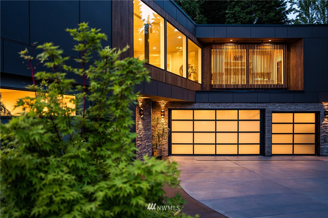DK Design & Build's newest project, the Oak & Iron House, just 1 mile from Bellevue Square, at the end of a quiet cul-de-sac. Thoughtfully crafted w/a Mid-Century Modern palette. In collaboration w/Metrica Architects, this custom home focuses on creating extraordinary volume & light w/floor-to-ceiling windows, floating stairs & skylight clusters. Exceptional entertainment spaces w/heated outdoor dining & living areas. Walls of glass expand the great-room footprint, creating a warm & captivating atmosphere perfect for PNW summer nights. Featuring 5-bedrooms (3 en suites), theatre room, gym (or 6th-bedroom), media loft, outdoor kitchen, office, & three-car garage. Perfectly positioned a few blocks from the best schools Bellevue has to offer.