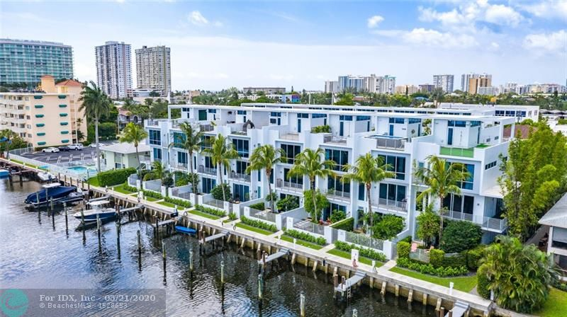 Rarely available waterfront Townhome in quaint gated community blocks from the beach; includes deeded boat dock accommodating up to 40' boat (lift possible). Enter from either the courtyard or 2 car garage to find the 1st bedroom with en-suite bath, perfect for an office or guestroom. The polished concrete floors glisten from the natural light coming in from floor to ceiling impact windows. The second floor features an open concept living/dining space & large kitchen with oversized island & a gas stove. Guest bath & laundry off kitchen. Third floor offers master suite along with the 3rd bedroom & full bathroom. A private elevator takes you to a large rooftop terrace with dining space & a Jacuzzi overlooking the water. Incredible location, walking distance to tons of shops andrestaurants!