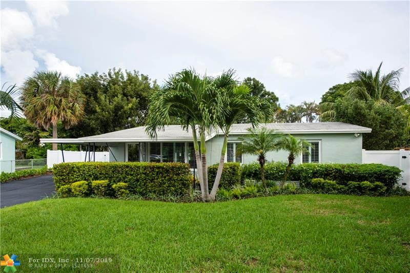 This house is the best kept secret in Wilton Manors with the most beautiful renovations, on a private court! A 3/2 mid century modern masterpiece on an oversized gorgeous lot with fruit trees and a spectacular private pool! Enjoy the views from the tranquil family room with floor to ceiling windows all around! The home of your dreams boasts a BRAND NEW kitchen with quartz countertops, new stainless appliances, gorgeous bathrooms, impact doors and windows throughout, plantation shutters, a laundry room, front porch, freshly painted, new electric, stunning light fixtures, plank flooring, new white PVC fencing and the list goes on and on! This location can't be beat! Walk to Wilton Drive, only a few miles to the beach and all Fort Lauderdale has to offer. Don't miss this MUST see gem!