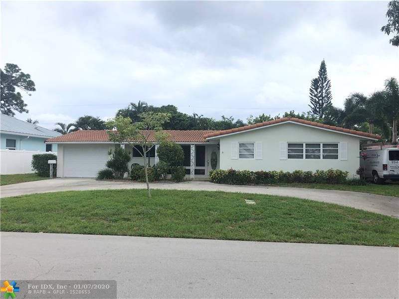 Great location east of US1, minutes to the beach.  This home offers a large lot with a fenced yard, circular driveway, covered patio and a 1 car garage.  Newer kitchen, tile flooring, newer roof & newer a/c.  This home has great bones and lots of potential.  Front living room window and sliding door in dining room are impact.  Shutters for the rest of the home. Laundry in garage. Located on a very nice street just west of 12th Ave. Yard has lots of room for a pool, boat/trailer, RV, etc.  Minutes to the beach area and it all it has to offer!