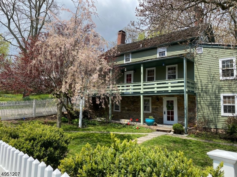 Circa 1790's, Restored Bank House with1990 Addition and 2014 to present updates/remodeling respectfully honoring the history of this three bedroom, two full bath residence regally set on .25 ac w/pond & stone patio, landscaped yard and 2018 picket fencing. Features incl: 2019 exterior & interior newly painted, refinished wide plank pumpkin pine flooring, 2013 remodeled master bath with heated flooring, updated gourmet kitchen 2012 with Diamond Cabinetry, Kitchen Aid appliances, 2017 wall ovens and copper sink, three fireplaces, master bedroom suite w/sitting room and lux master bath, cathedral, beam ceilings and so much more!  One car detached garage and additional 1/2 car garage, loft storage.