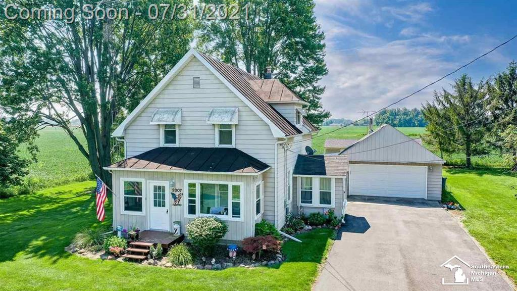 """Beautiful Erie Twp. home on a nearly 1-acre, tree-lined private lot. Main floor bedroom and full bath. 2 large bedrooms w/large closets upstairs. Also upstairs is a 14x7 """"Bonus"""" open area/perfect office! Huge garage w/loft storage, work bench, generator. Replacement windows. Newer gas boiler & AC air handler. Clean basement w/glass block windows. Updated electric. 2 large sheds. Covered rear patio overlooks tranquil crops."""