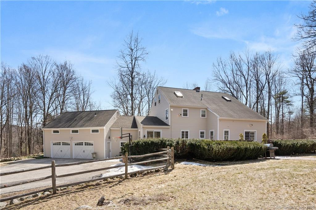Quietly tucked away in West Simsbury resides this classic Colonial home that expands over 4,662sqft offering 5+ bedrooms, 3.2 bathrooms & rests on 8.85+acres including the private lot next door. This home is more than meets the eye & is a must-see w/it's wonderful layout w/lots of updates & upgrades! Inside is light, bright & inviting while offering a warm homey feeling of rest & relaxation. Each room offers a plethora of windows allowing year-round stunning views. 1st flr w/half bath, laundry room, office, master suite, family room, sizable living room crowned w/fireplace & hidden beverage cabinet all outlined w/custom millwork. Formal dining room w/glass French doors opening to the updated granite kitchen. Kitchen features matching appliances, large island, breakfast nook, slides and gives way to homes 2nd staircase & the most wonderful sunken sunroom with soaring ceilings, skylights & sliders! 2nd flr with the homes 2nd master suite w/full bath & fireplace, 2 bedrooms & 1.5 bathrooms. 3rd flr is this wonderful space for a rec area, offices, 2nd family room or whatever your needs might be. Unfinished lower-level w/loads of storage! Outside is an entertainers dream w/an oversized deck, enormous built-in chess board, inground heated pool w/spa all outlined w/fencing & highlighted w/mature shrubs & trees providing year round privacy & a brilliant color display. Hidden value updates include; refinished hardwood flrs, newer furnace, H2O tank, stained deck, refinished pool & roof