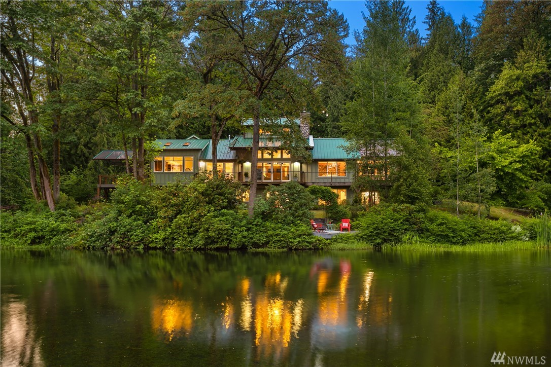 Imagine your own 4-acre estate, complete with pond and forest garden, just minutes from Redmond and Bellevue. This contemporary lodge-style craftsman home takes advantage of the arc of the sun for light and warmth. The south-facing, skylight-filled kitchen and great room face the riot of nature's activity on the pond and meadow. The floorplan is truly inspiring with decks that blend indoor with outdoor spaces. A stunning little garden cottage and 3-bay shop/barn add to the extensive grounds.