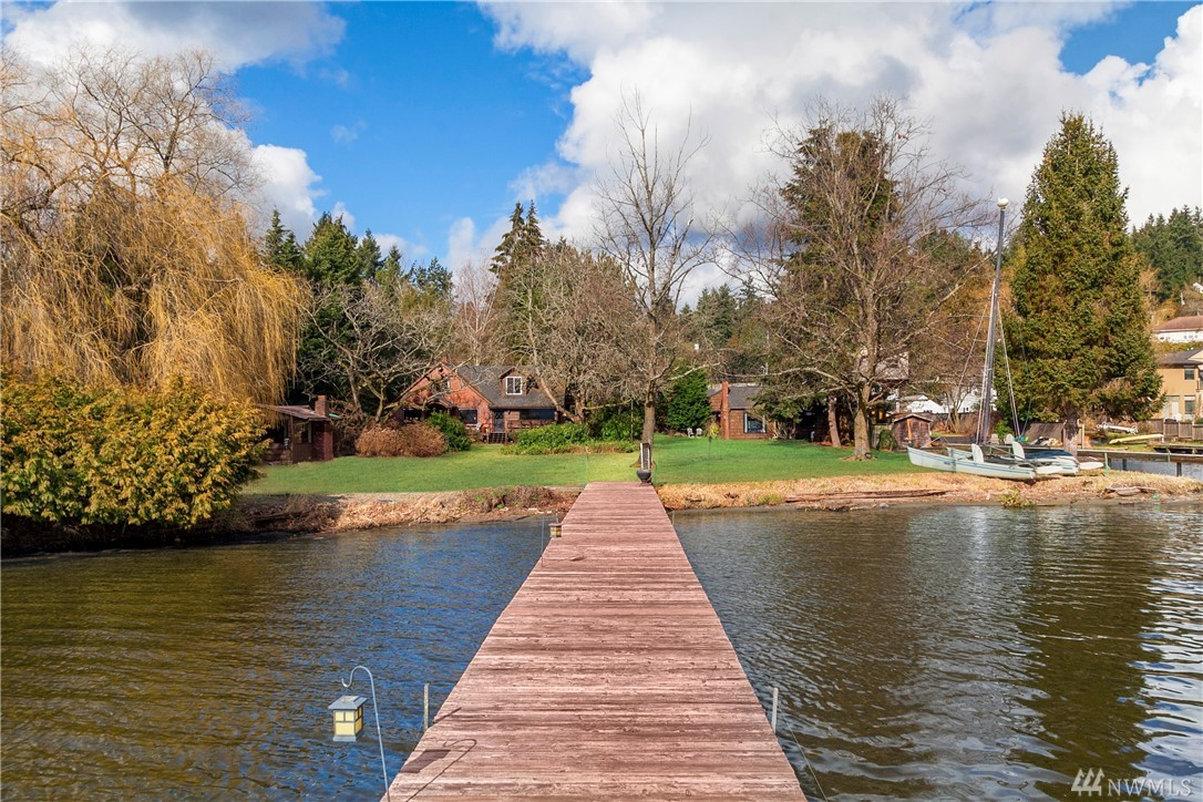 Lake Forest Park's iconic Lake Haven - one acre plus of coveted south facing lakefront. Level, park-like acreage incls 150+ feet of no-bank waterfront adjoining Lyon Park for tremendous privacy. Vintage home, 6 cabins & huge dock. A+ location - next to LFP Civic Club & Town Center, Burke-Gilman Trail, Kenmore Air, Inglewood CC & equidistant to Seattle & Bellevue. Zoned RS7200 – great development potential. Rare opportunity to develop a signature waterfront plat, or create your own special haven!