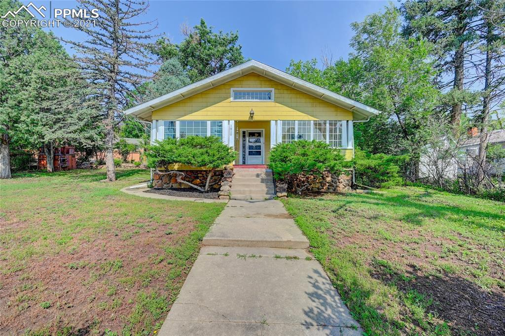 """A Craftsman-style home, nestled in the ever-charming Cheyenne Canyon  -  where hiking, biking, and dog walking are enjoyed by many * within walking distance to the entrance of both North and South Cheyenne Canyon, the Starsmore Nature Center, Seven Falls, and just minutes to the World- famous Broadmoor Hotel.     Most all windows were replaced in 2019 * furnace replaced in 2019 *  new carpeting in 2019*     *combination Living Room / Dining area (28' x 11') * Sun Room * French Doors to Bedroom, off Living Room * Covered, Front Porch.      * This home IS a """"fixer upper,"""" and  is being sold in """"as is"""" condition.    * It has an excellent rental history!"""