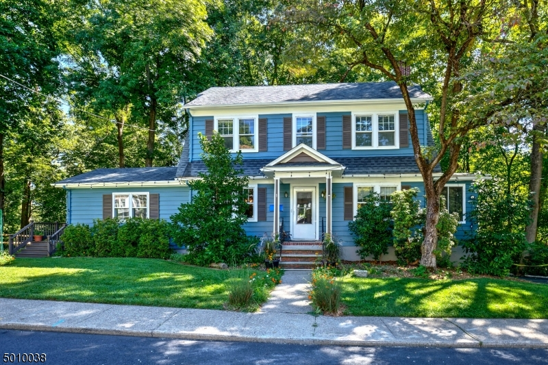 Sunny, charming Colonial on quiet cul-de-sac, yet minutes from The Green.Rich chestnut trim. Eat-in kitchen (2000) w/cherry cabinets, granite counters, center island, skylight, back yard living spaces M. BR with full bath is conveniently located on 1st floor. Formal living room has a wood-burning fireplace insert. Formal dining room has 2 built-in display cabinets. The office with a built-in cabinet is off the living room. Hardwood, tile and carpeted floors.  Accessible from the kitchen, a beautiful deck with plenty of shade overlooks tall trees and a fenced back yard secure for pets. The 1-car garage has direct entrance to the house from the full basement. Additional parking spaces. All public utilities & natural gas. Quick access to Elliot Street tennis court, playground, community garden and Patriot's Path.