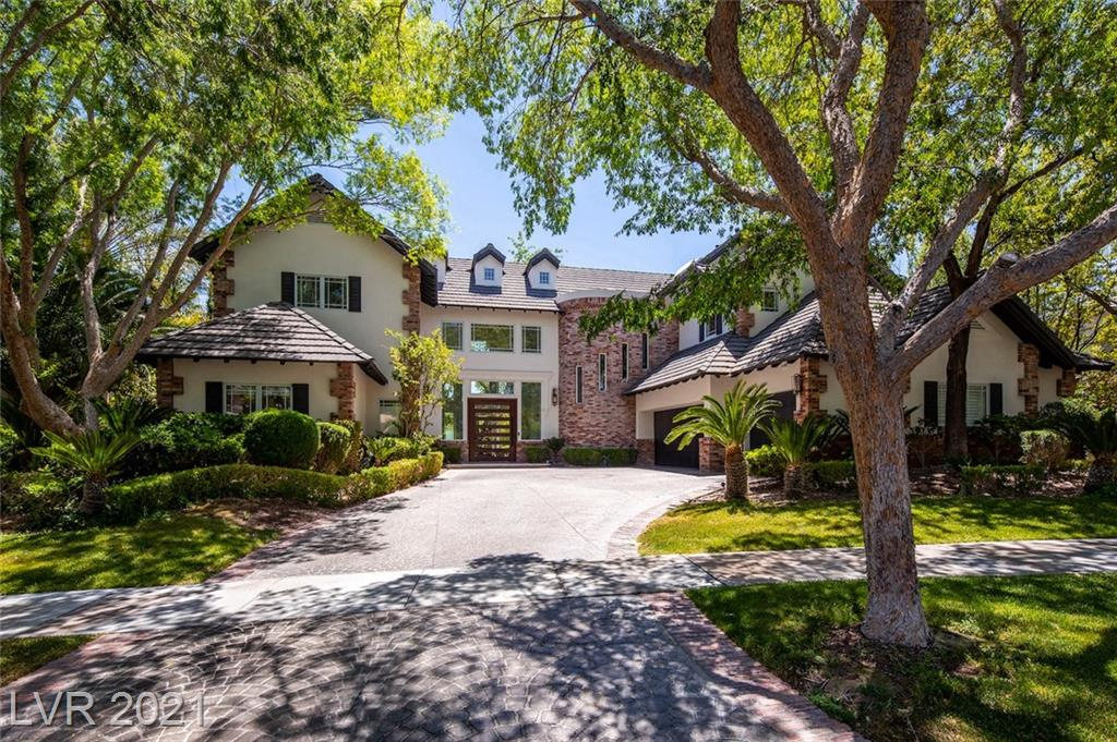 No architectural or design feature shouts for attention in this superbly executed contemporary estate in Eagle Hills. A highly individualized two-story residence with six bedrooms, seven baths, a two-story formal living room, and elegant adjacent dining space. The stunning kitchen, with a double-oven Wolf range, also has a built-in stainless refrigerator with separate freezer and wine storage columns, a large island with a second prep sink, and an informal dining nook. A large wet bar with counter seating has wood flooring and a unique wood ceiling that complements the decor of a comfortable adjacent den/media room. The master suite features a soaring ceiling, built-in window seat, and access to a private outdoor space. The ensuite bath boasts dual lavatories, a freestanding modern soaking tub, and a glass-walled shower. A fully landscaped rear yard with a large, covered patio, built-in grill and serving counter, and a sparkling pool and spa.