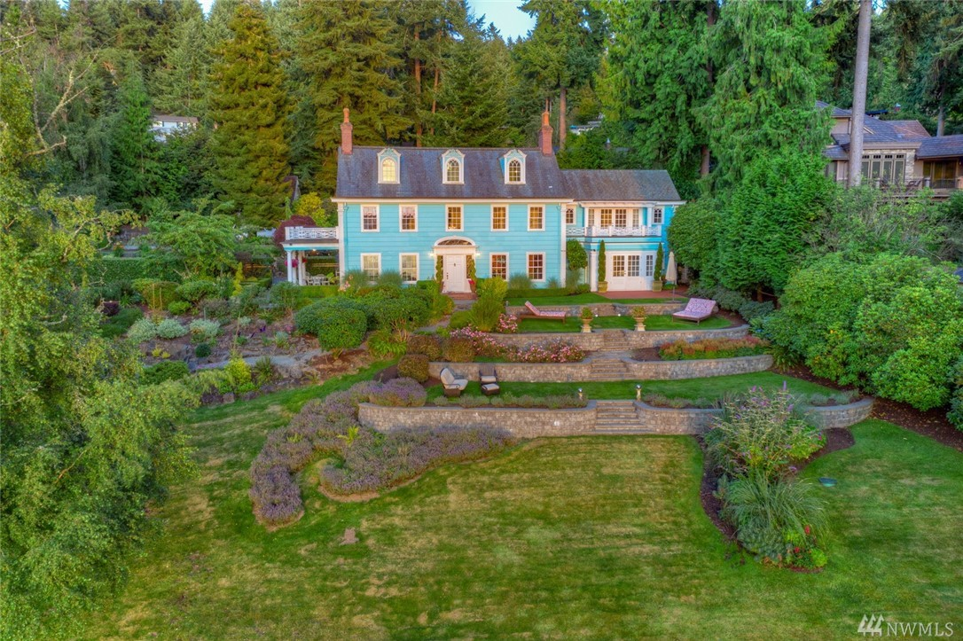 Welcome to the historic WFT community of Three Tree Point & this 1918 restored Colonial Revival home. Set on 1+ acre of park-like grounds, w/rolling lawns, mature plantings, charming arbor & meandering paths, this amazing estate tells stories of a past era while offering today's luxuries: marble surfaces, tin ceilings, original custom moldings, period details... Surprisingly spacious rooms leading to a myriad of views: water, mountain, islands & sunsets. Beach access right across the street.