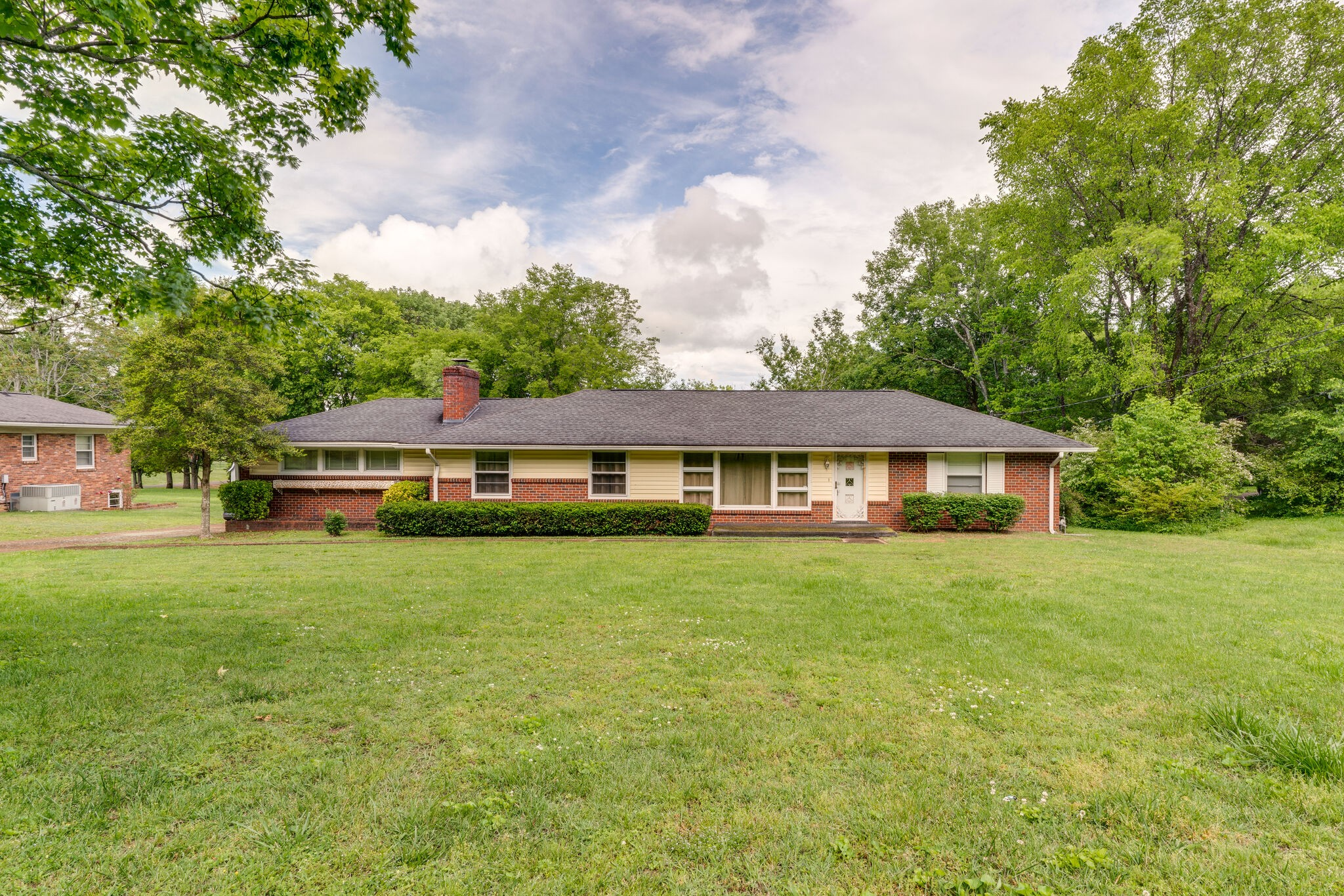 Brick immaculate home on large almost acre level lot!  2 car attached garage, storage building, original hardwood floors, updated bath & kitchen! Great Location!