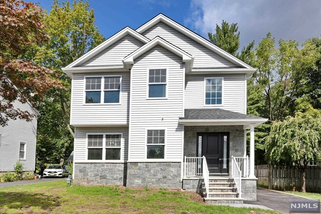 """Stunning new construction on existing foundation featuring 5 bedrooms and 4.5 baths over 3,200 square feet. Front porch entry brings you into the 2 story foyer. From there a formal living room with panel moldings flows into the spacious dining room with coffered ceiling. Large eat-in kitchen has 60"""" fridge and freezer, 2 sinks, 2 dishwashers, double oven, warming drawer, and a microwave. From the kitchen you can see into the family room with more detailed trim work and sliding doors to the backyard with covered porch. Off the hallway is a powder room, mud room and plenty of closet space. Upstairs is a luxurious master suite with a walk in closet and spa like bathroom featuring double sinks and a large walk in shower. The second floor also has 4 more bedrooms, one of which has an ensuite bath, and 1 full hall bath and laundry room. The basement has a playroom with tons of storage, full bathroom, and office. 3 zones of HVAC and fenced in yard."""