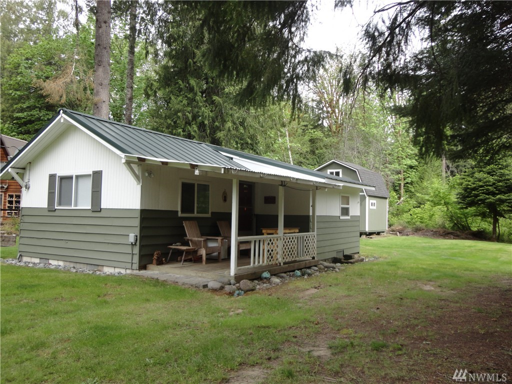 """Clean and well maintained, this cozy cabin is """"turnkey"""" ready for you to enjoy or would make a great rental.  Large shed with loft could easily convert to a bunkhouse. Packwood is a year-round outdoor recreation area surrounded by Mt. Rainier National Park, the White Pass Ski Area, and the Gifford Pinchot National Forest  The High Valley community has community pools, 9 hole golf course, a community center & play area, community access to the river and walking/biking trails along the main road."""
