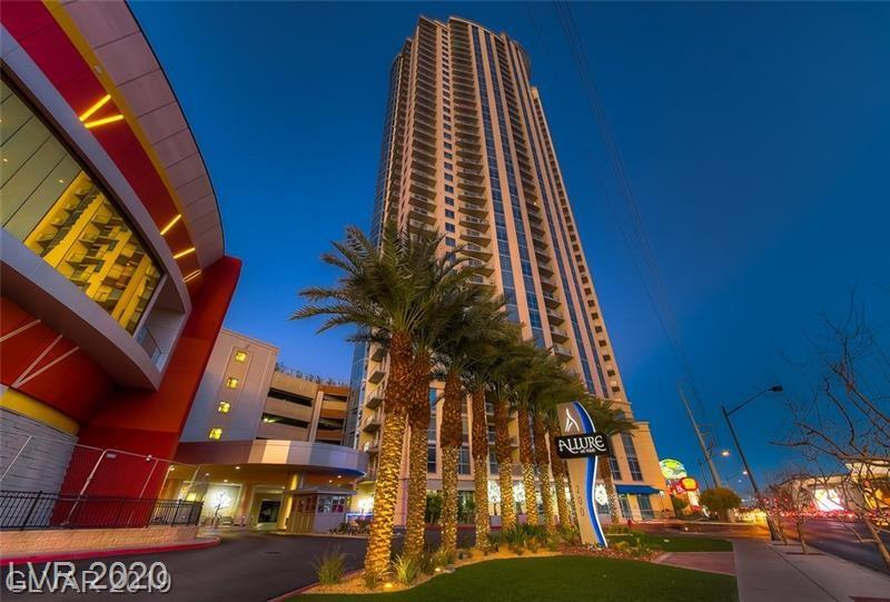 Amazing FULLY FURNISHED Condo in the Allure. Live on Las Vegas Blvd.  Close to Casinos, restaurants, shopping, concert venues, Raiders and T-mobile stadium. ( home of the Golden Knights) This 2 bedroom condo has it all, Stainless appliances, front load washer and dryer, wine fridge. Beautiful wood flooring that look new. Master bath has oversized jacuzzi tub and separate shower. This condo has never been lived in. Only a vacation home that shows like NEW! The views from every floor to ceiling window is of the Strip!  Views Views Views
