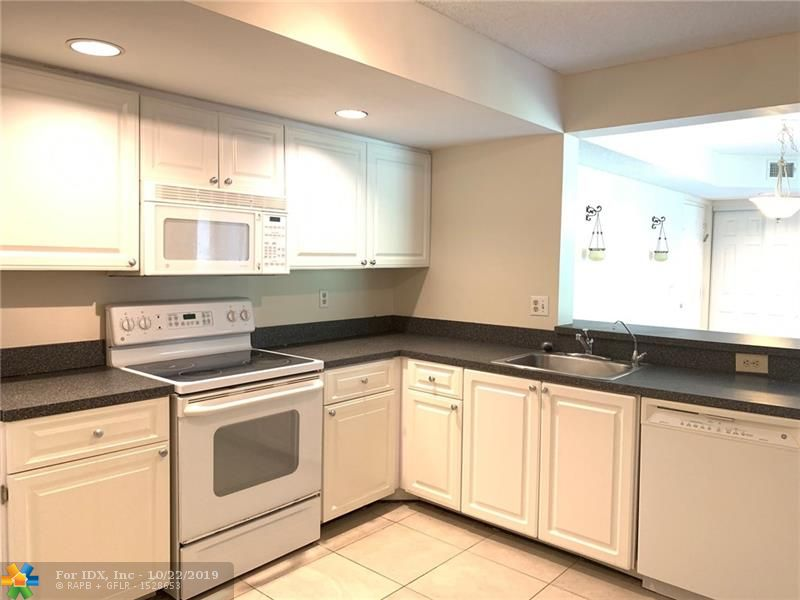 GREAT OPPORTUNITY TO OWN THIS UPDATED GROUND FLOOR 2 BEDROOM 2 BATH CONDO IN THE QUIET COMMUNITY OF GRAND OASIS LOCATED ON THE BORDER OF PARKLAND. CORNER UNIT WITH A LAKE AND NATURAL WILD VIEW. NEUTRAL PAINT & TILE FLOORING THROUGHOUT, EAT-IN KITCHEN WITH GRANITE COUNTERS, PANTRY, WASHER/DRYER, WALK-IN CLOSET IN BEDROOM, UPDATED BATHROOMS, RESORT STYLE COMMUNITY HAS POOL, JACUZZI, GYM, TENNIS COURT, BBQ, CLUBHOUSE, NO RENTAL RESTRICTIONS, QUALIFIED FOR FINANCING 10% DOWNPAYMENT.