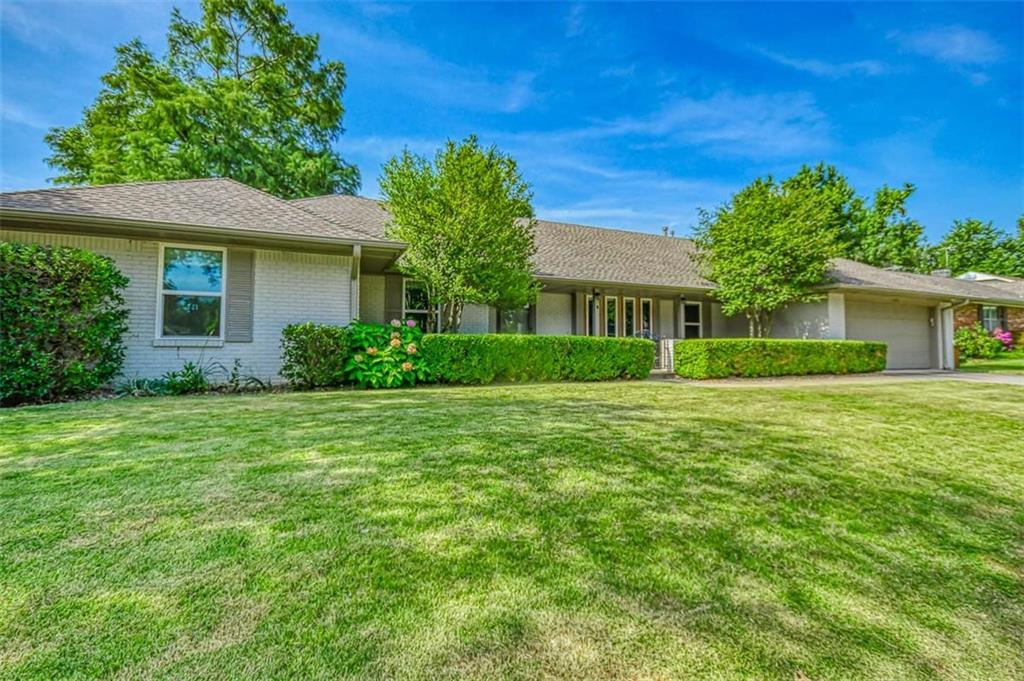 Sprawling Mid Century Modern in the heart of Norman.  Walk to neighborhood schools and walk or bike to Campus.  Located on a quiet cul-de-sac perfect for kids.  Updated paint, designer light fixtures, wood floors, 5th bedroom is perfect for a home office.  Lots of natural light.  Master bedroom has great view of backyard, garden and pergola.  Windows and sliding door have been replaced.  Lots of natural lights.  Cozy fireplace in the family room or watching TV.  Front living/dining perfect for entertaining.  Kitchen has built in buffet and serving area, breakfast bar, great dinette with view of backyard and patios. Kitchen has lots of sold wood cabinets and great work space for the cook in the family.   Large pantry in the utility room, along with 1/2 bath and door to backyard.  Extra deep garage.