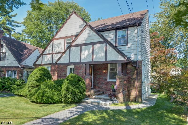 Beautiful Colonial Tudor featuring original oak floors, just refinished. Steps from Clinton Elementary School & jitney (on the corner) to NYC trains. Spacious living area including finished basement. Freshly painted with refinished original oak floors featured in this bright tudor in Maplewood. Conveniently located just steps to the jitney stop to NYC trains and Maplewood Village. The first level offers a living room, dining room and family room/office. Upstairs has 3 BRs and 1 bath. The third level has a large finished BR or bonus room with a private full bathroom. The basement is a finished recreation room with a full bar for entertaining. Enjoy a cup of coffee on the screen enclosed back porch overlooking the well-manicured lawn. Detached two garage & plenty of off street parking with a private driveway.