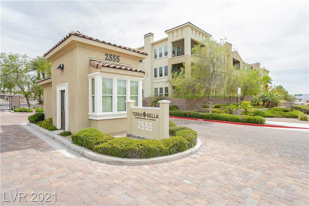 Rare opportunity to purchase a top floor Fiji model luxury condo in Terra Bella at Anthem! Super livable! Located in the newest building in the community! Perfect place to reside all year round or a vacation home. 55+ & gated. Large tiles, granite countertops practically new! Quality throughout! High windows/ceilings. Roomy deck. Cook's kitchen, 5-burner gas cooktop, island, pantry, great lights, and more than enough cabinet space. Laundry room has sink next to Home office nook. Sleek electric fireplace. Beautiful Kohler baths! ADA Toilets. Exquisite clubhouse & pool. Great mountain view! Downsize with ease! 2 BED, 2 BATHS, large master bedroom, large master bathroom with grab bars. Not to mention a Roman Atrium central courtyard & elevator service in each building.