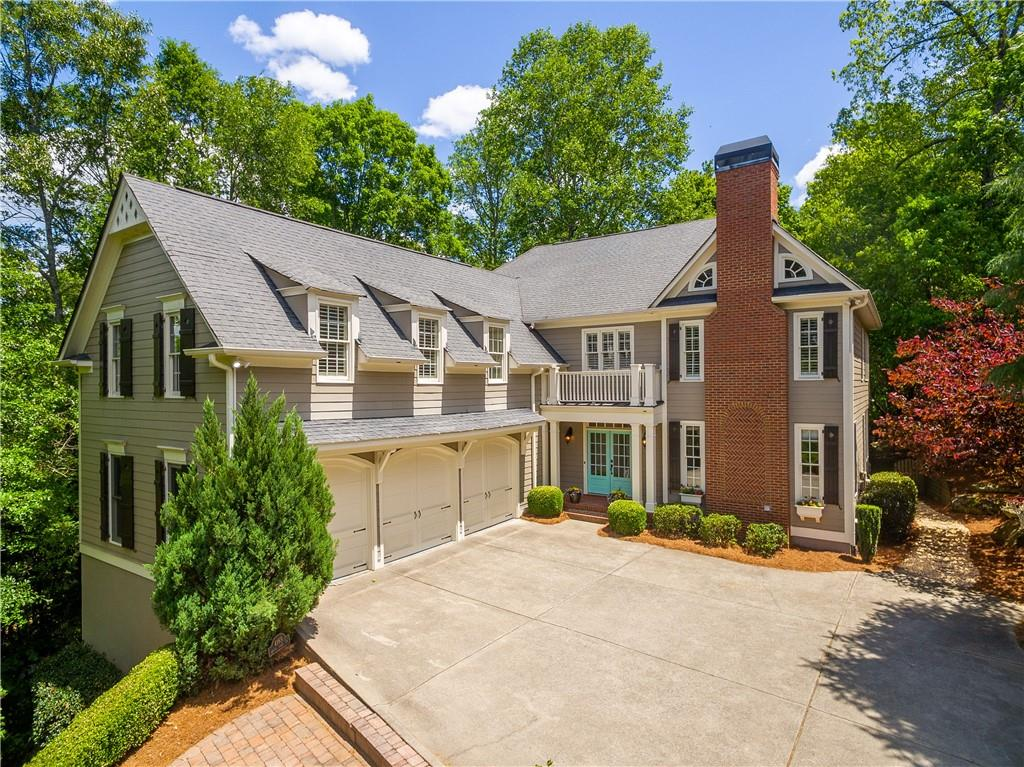 Privately Located Home with 3 Car Garage. Chattahoochee River frontage. An inviting kitchen w/floor to ceiling windows and serene view of back yard. Keeping room with Stone Fireplace. Home boast hardwood floors throughout. Open Kitchen offers an island with an open breakfast are. Formal Dining with a beautiful view. Large Great Room that leads to a screened porch. Trex deck wraps the backside of home. Large bedrooms, Plantation Shutters upstairs. Walk in closets.