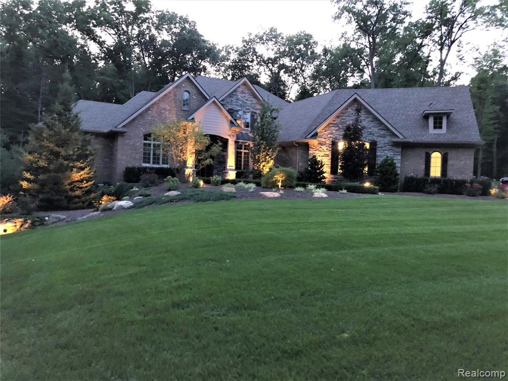 CUSTOM BUILT BEAUTY has over 6,000 sq. ft. living space w/premium stone & brick elevation & finished LL walk-out situated on private (2 acre) tree lined lot. Professionally landscaped & manicured includes paver patios, stone steps, boulder walls, built in hot tub & fire pit. Gorgeous covered entry leads to premium HW floors T/O most of main level. 2 story GR, DR, Library w/built-ins. Kitchen w/wood beams, custom cabinetry, granite, premium SS appliances, pantry & DW to patio. 1st floor MB Ste w/2 walk-in closets with organizers, lux jet tub Bath and lg. shower. Upstairs includes princess Ste. & 2 BR w/Jack & Jill Bath. Pro. Finished LL includes Rec Room w/kitchen, built in pizza oven & DW to patio, FR, Office/BR, full Bath, home gym, hobby Rm. 1st floor Laundry & Mudroom. 5 car heated Garage w/built in storage, epoxy flooring and direct access to LL. NEW WHOLE HOUSE GEN. & HWH. INCLUDES 2ND LOT WITH SEP. PARCEL ID #1120276010. PLEASE MAKE SURE AND INCLUDE THIS. AGENT RELATED TO SELLER