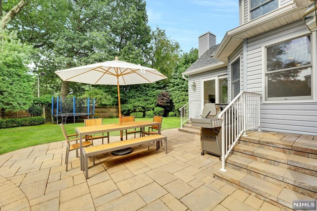 LOCATION!! Come see this beautifully expanded & updated 4 bdrm, an office, & 3.5 baths Colonial on Tenafly's East Hill.  With the renovation completed in 2016, no details were spared. Entering into a soaring foyer connected to living rm, the 1st fl features open space plan w/ great flow, abundance of natural light. All bathrooms were built using Porcelanosa tiles & top fixtures. The large open kitchen features top appliances, a large modern island w/ Caesarstone countertop, white cabinets, and is open to the large family rm with a gas fireplace. Off the kitchen is a spacious bfast nook, a door to the gorgeous & private backyard & a powder rm. 2nd fl features a HUGE master suite with a vaulted ceiling, a modern full bathroom & 3 generously sized bdrm. Fully finished basement with many windows featuring a large recreation rm, a finished rm & a bathroom. New garage door & A/C (2016), new roof (2020) w/ warranty. Walk to school, NYC transport & houses of worship. A DEFINITE MUST-SEE!