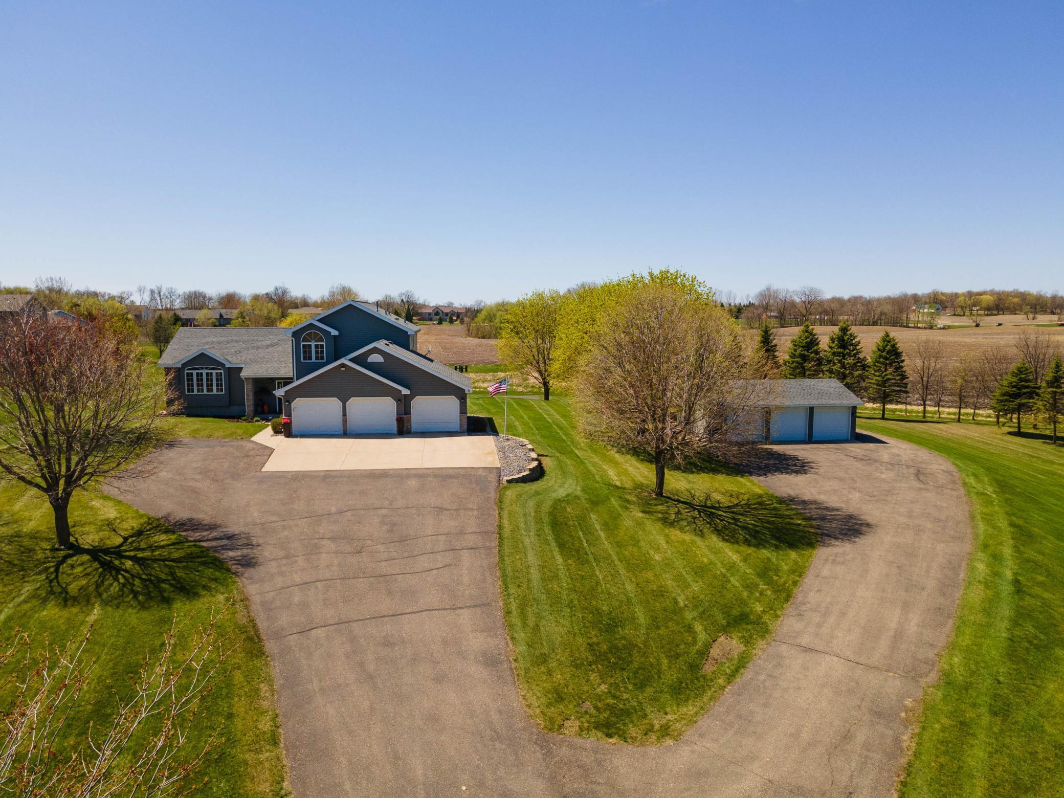 Absolutely gorgeous multi level home on 10 acres has everything you could want and more.  Beautiful views, in the country feel, spacious living and 6 garage stalls are some of the things you will appreciate about this home.  Great layout featuring a huge master suite with two additional bedrooms upstairs.  On the main floor you will find a layout perfect for entertaining - large kitchen, living room and family room with gas fireplace.  Lower level features additional family room and space that could be a 4th bedroom.  Attached, heated and insulated triple stall garage as well as an additional triple stall insulated garage has plenty of room to store the toys and do the projects.  Located across the street from Lake Latoka, backyard features its own basketball court and overlooks its own 10 acres of rolling fields.  Check this one out today!
