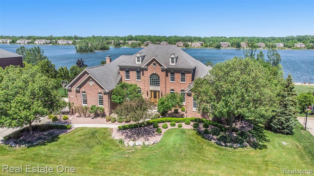 """Spectacular waterfront home in Island Lake of Novi which has been completely updated with all top of line flooring, fixtures, cabinets, countertops, appliances, new marble fireplace, closet organizers, window treatments, doorwall to deck, and more in 2020-2021!  No expense has been spared in this 6 bedroom, 4 1/2 bath mansion with a 1st floor master and finished walkout basement with 2 additional bedrooms, exercise room, and full bath.   The list continues with a whole-house sound system, 2 new garage doors and openers, a new """"under deck oasis"""" below the large deck which then extends to a huge open patio with a view of the lake and private beach. The community clubhouse offers many amenities, plus an Olympic size pool, sand volleyball, tennis court, etc.  All measurements are approximate."""