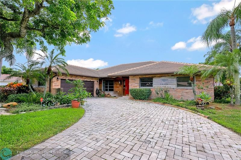 """Unique Custom Brick Exterior 4/2 W/Salt Pool On Wide Canal-Side Entry Garage-Lush Landscaping Front & Rear-Limited Traffic Location-Amazing List Of Updating Includes 2018 Roof-2017 5 Ton Rheem A/C-2016 Anti Erosion """"Lot Wrap"""" Canal Restoration-Pool Updated 2012 Salt System-Outside Patio Shower & Pool Cover-High Efficient Heat Pump For Pool-2005 Chiseled Marble Paver Drive-2003 Kitchen Remodel W/Granite/Wood/Stainless/Wine Cooler/Lighting-Huge 45x14 Covered Screened Patio & 28x13 Open Patio-12' Family Room Vaulted Textured Ceilings W/Bose 3 Zone Surround Sound-Utility Laundry Tub-2 Water Heaters, 1 For Master Only-72"""" Patio Hunter Fan-Canal Fed Sprinklers-15x5 Entry-Bdrm 3 Bamboo-Home Shown Under NAR/Florda Realtors/CDC Covid 19 Guidelines-Home Sold """"As Is"""" With The Right To Inspect"""