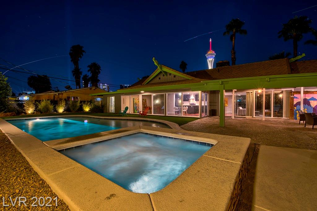 """Welcome to 'The Lava House' - A wonderfully eclectic home where Mid-Century Modern charm embraces Ultra-Modern! This is Vintage Vegas at its finest! Custom built in 1962 by casino execs Frank & Shirlee Schivo*Lovingly revitalized by passionate Cirque du Soleil Artist, Kent Caldwell*3,373sf, 4 Bed, 3.5 Bath, 2 Car, Ultra-Modern pool & spa with massive wet deck on a 14,810sf double lot*This home oozes charm*Unique, retro features: black lava rock walls, plush, built-in lava backed bar, sunken mosaic tile tub, original, Mid-Century Modern wallpaper, gold veined mirrors & extravagant, period-correct lighting*Chef's kitchen with original custom cabinetry, double islands, Quartz counters, S/S appliances & hip copper sink*Stunning 'Lava Look' epoxy treated concrete floors*Dream Master Bath: dual shower heads, 18"""" rainfall shower & spa bench*Huge covered patio*Endless pool views throughout home*Great location by Downtown, The Arts District & Fremont St*All furniture Included*Welcome Home!"""